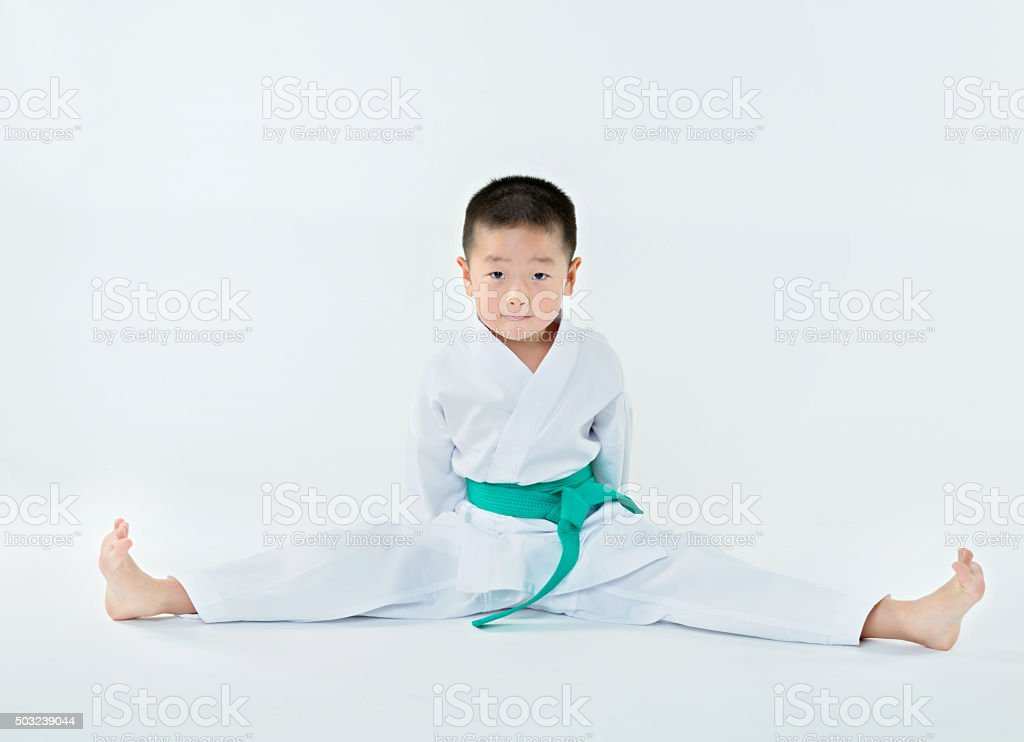 Karate boy stretch stock photo