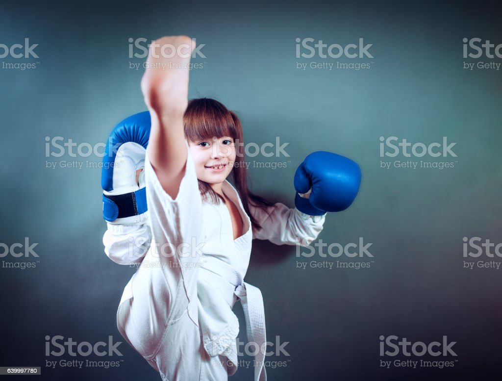 karate girl It fulfills kicks on  background stock photo