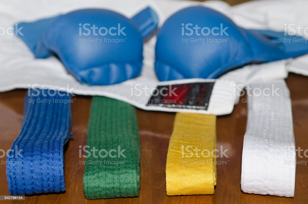 Karate gloves, belts and kimono stock photo