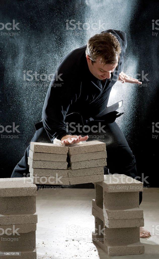 Karate Man Breaking Cinder Blocks stock photo