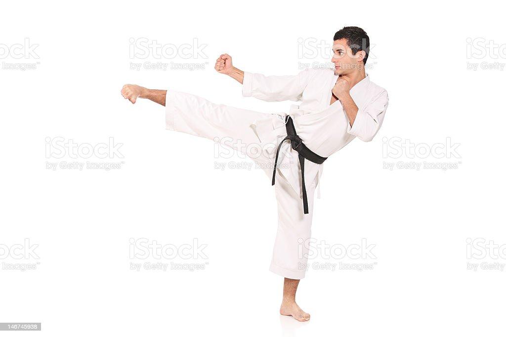 Karate man exercising stock photo