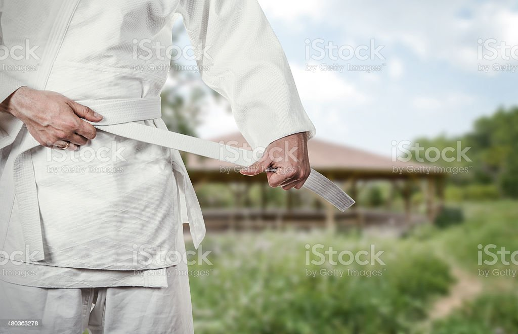 Karate master prepares for combat in high mountain village stock photo