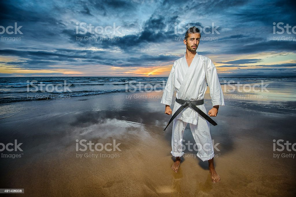karate master with dramatic sky stock photo