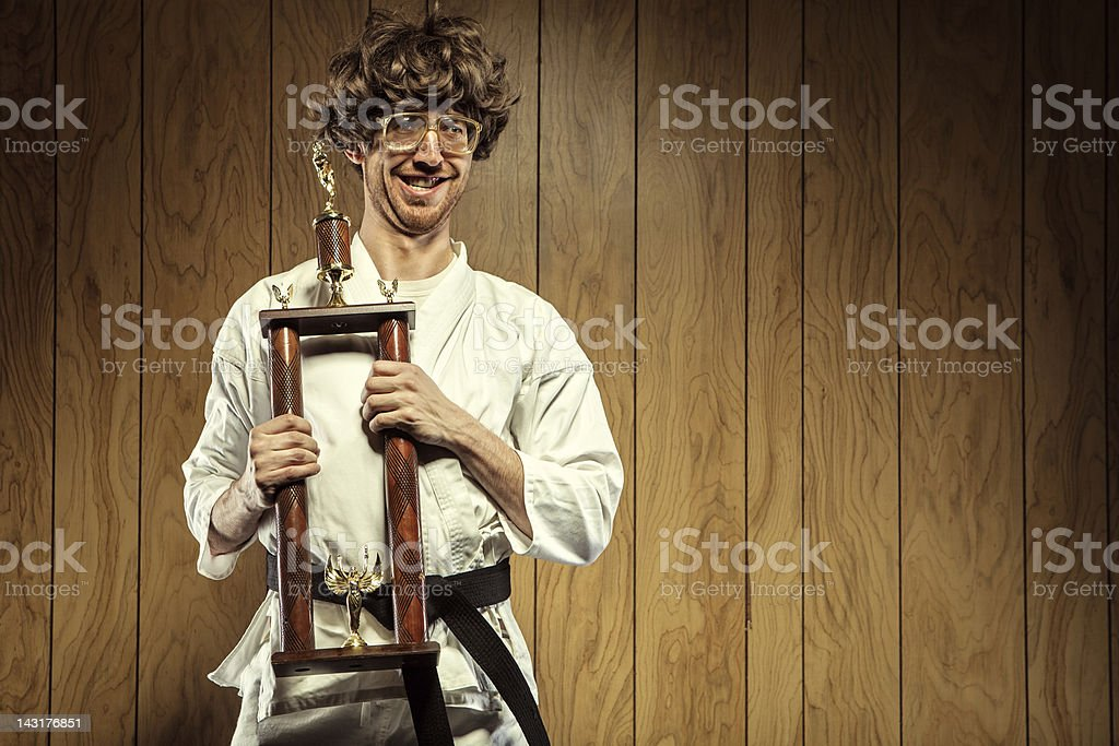 Karate Nerd is Proud of His Trophy royalty-free stock photo