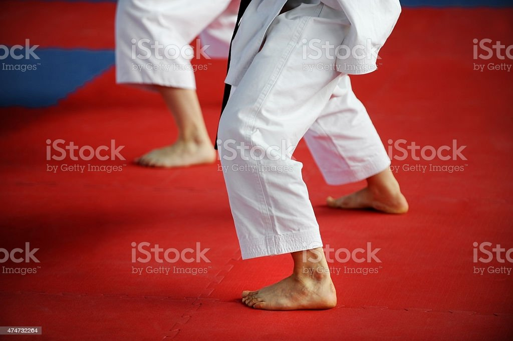 Karate practitioners on competition floor stock photo