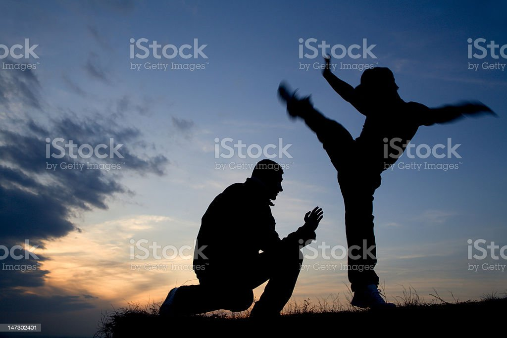 karate training by sunset - silhouette royalty-free stock photo