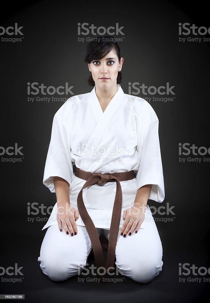 Karate woman in basic pose royalty-free stock photo