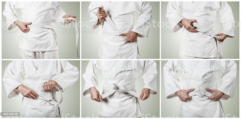 Karateka belt tying step by step pictures stock photo