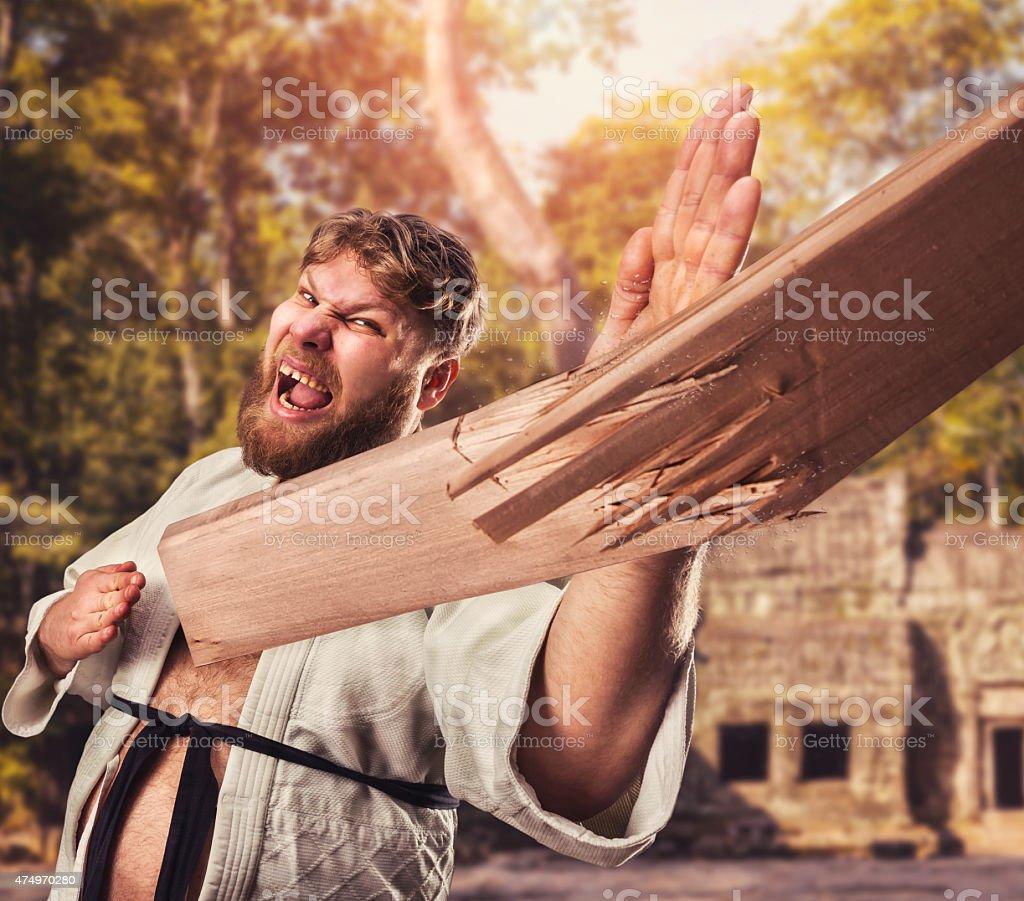 Karateka breaks board stock photo