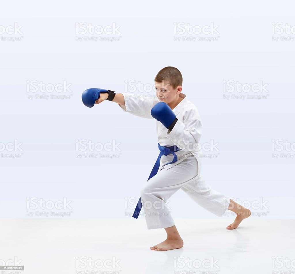 Karateka with overlays on the hand is beating punch arm stock photo