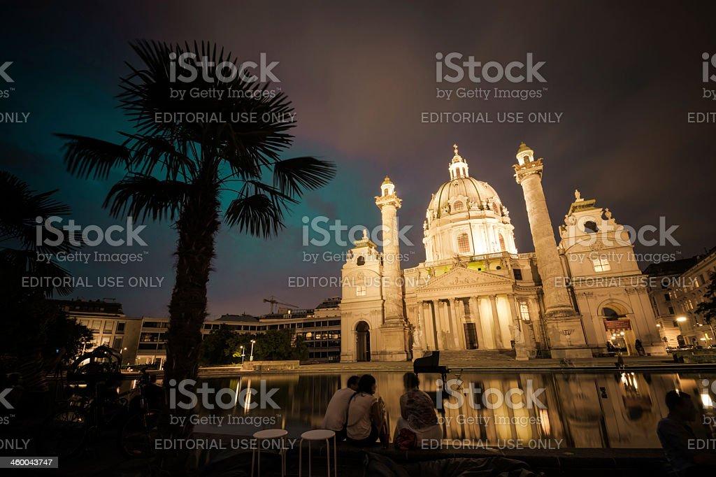 Karlskirche at Karlsplatz in Vienna, Austria during the nighttime stock photo