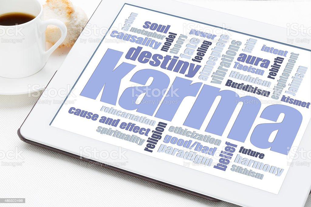 karma word cloud on tablet stock photo