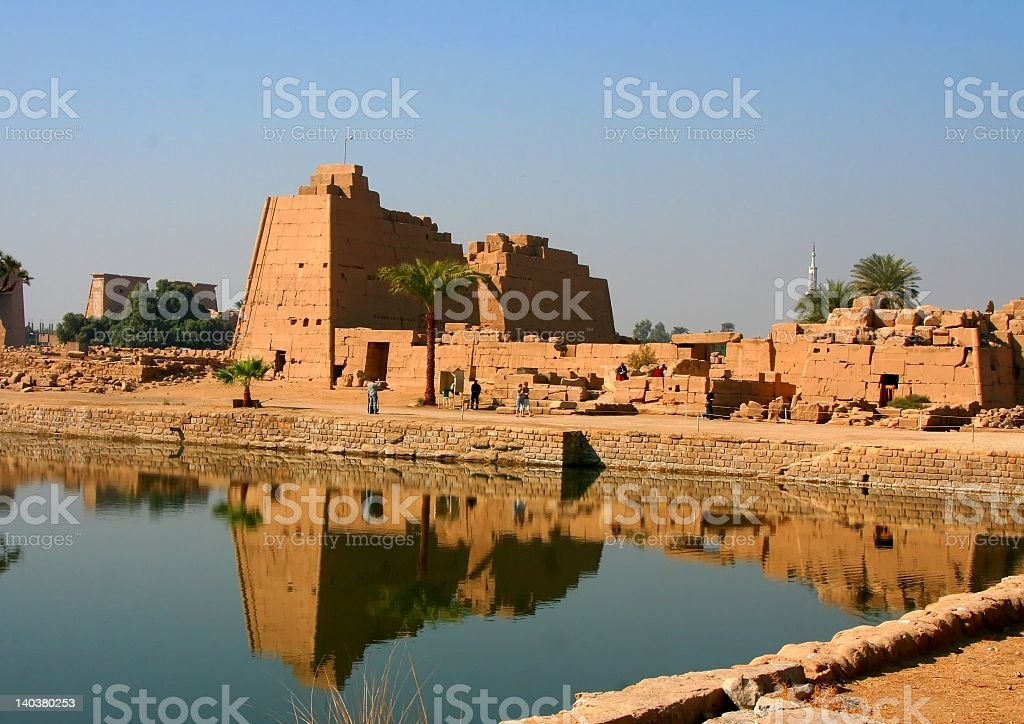 Karnak Temple in Egypt resting behind reflective waters stock photo