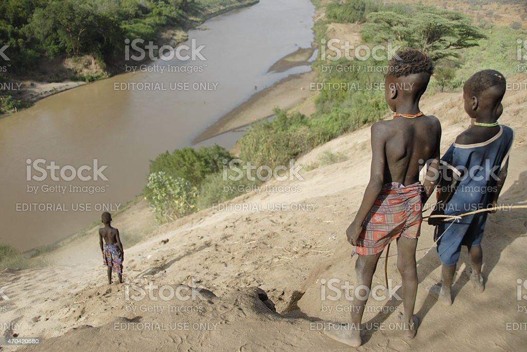 Karo kids down to river in Colcho, Omo Valley, Ethiopia. stock photo