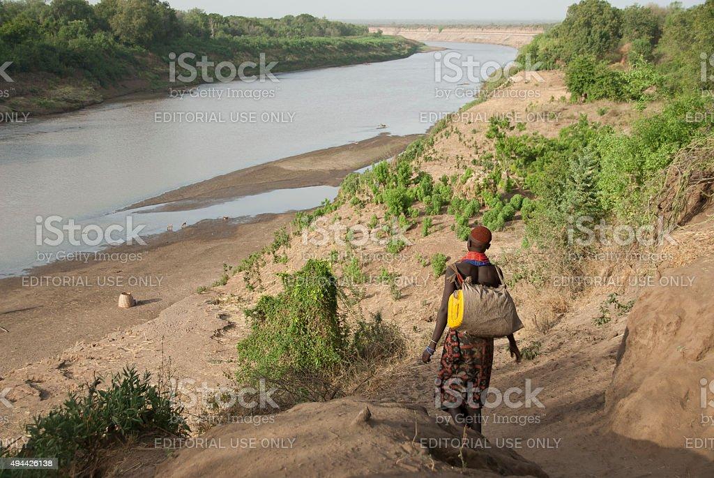 Karo woman down to the River Omo, Colcho, Ethiopia. stock photo