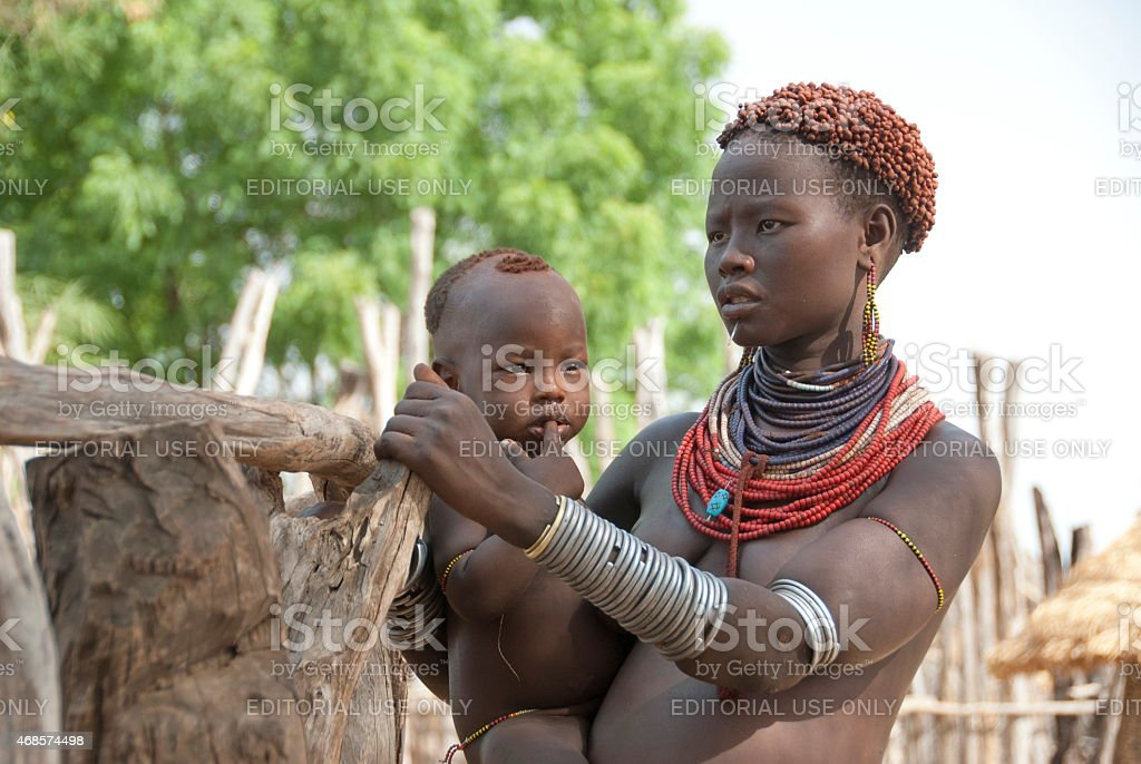 Karo woman with her baby in Colcho, Omo Valley, Ethiopia. stock photo