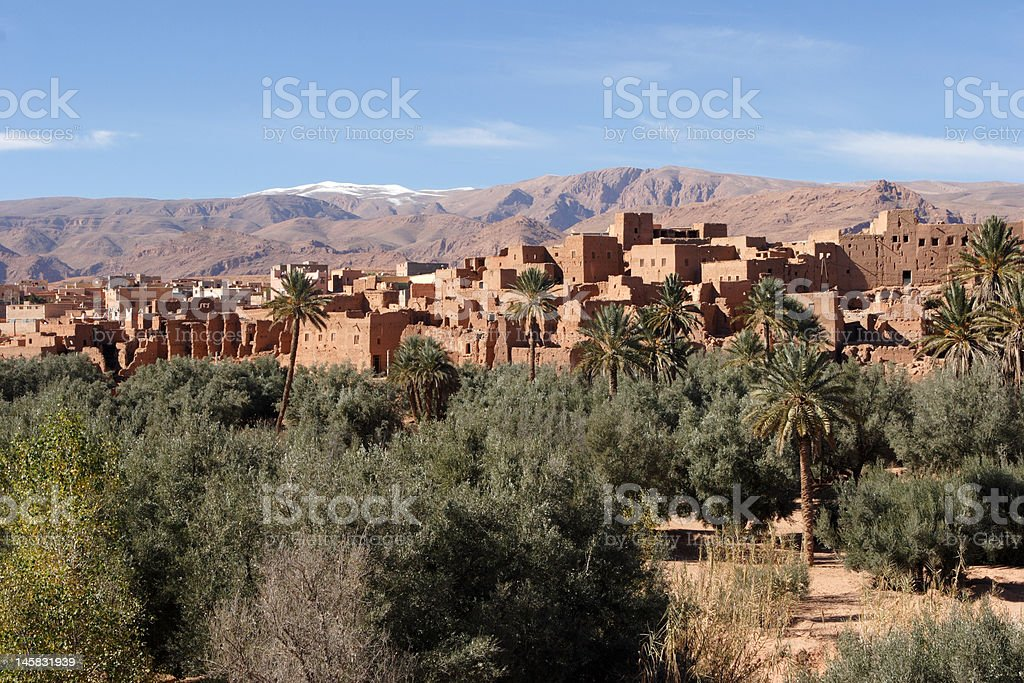 Kasbah of Tinerhir and Atlas Mountains in Morocco stock photo