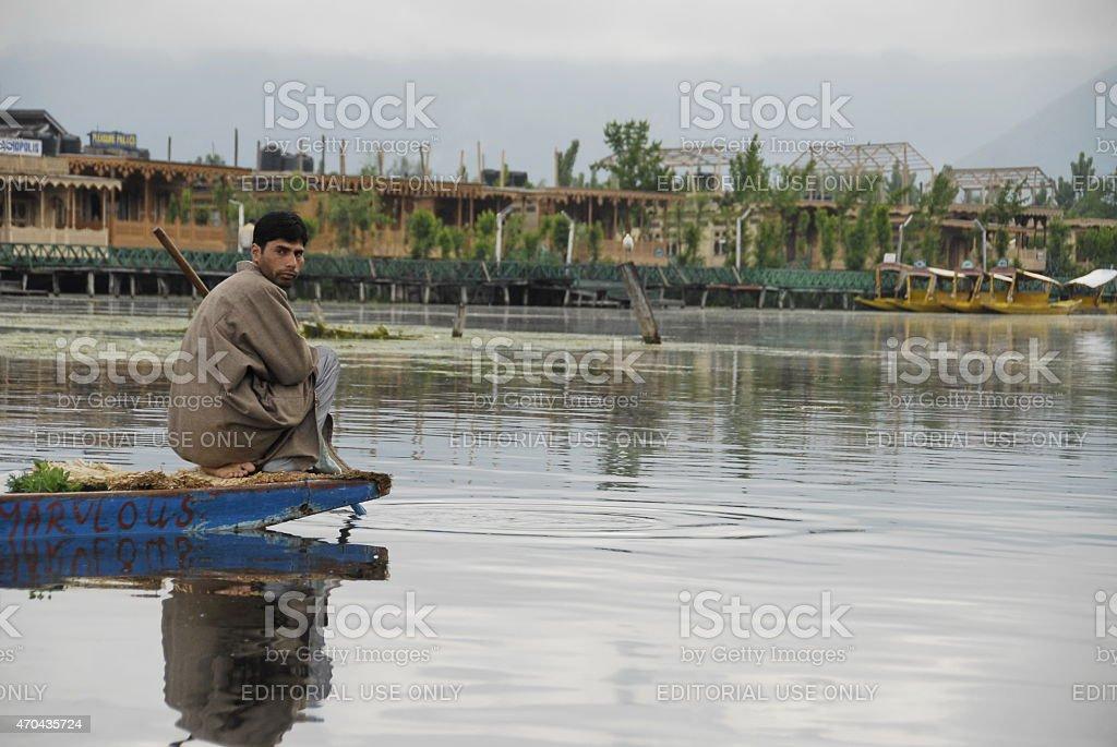 Kashmiri man goes fishing on the Dal Lake, Srinagar, India. stock photo