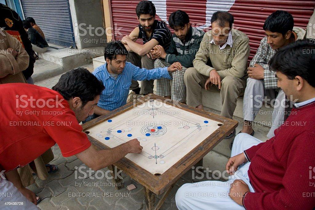 Kashmiri men play traditional board game 'carrom' in Srinagar, India. stock photo