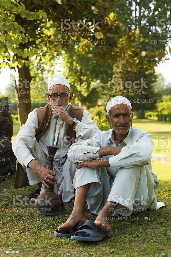 Kashmiri Men Sitting Outdoor Park Shisha Smoking stock photo