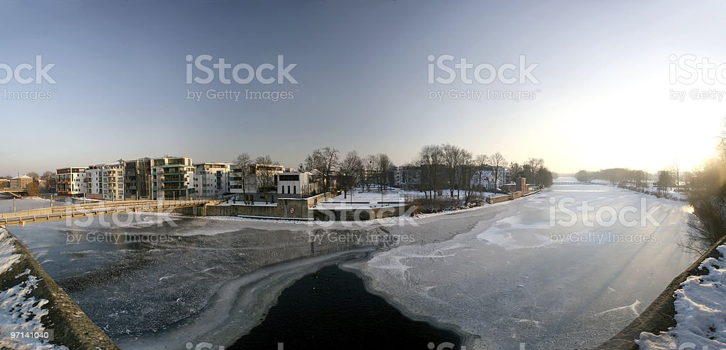 Kassel-Unterneustadt (Germany) and river Fulda with ice stock photo