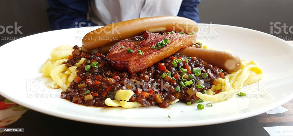 Kasspazle with pork belly and sausage stock photo