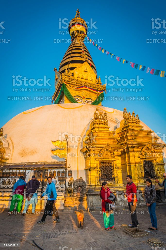 Kathmandu early morning visitors to Swayambhunath temple golden stupa Nepal stock photo