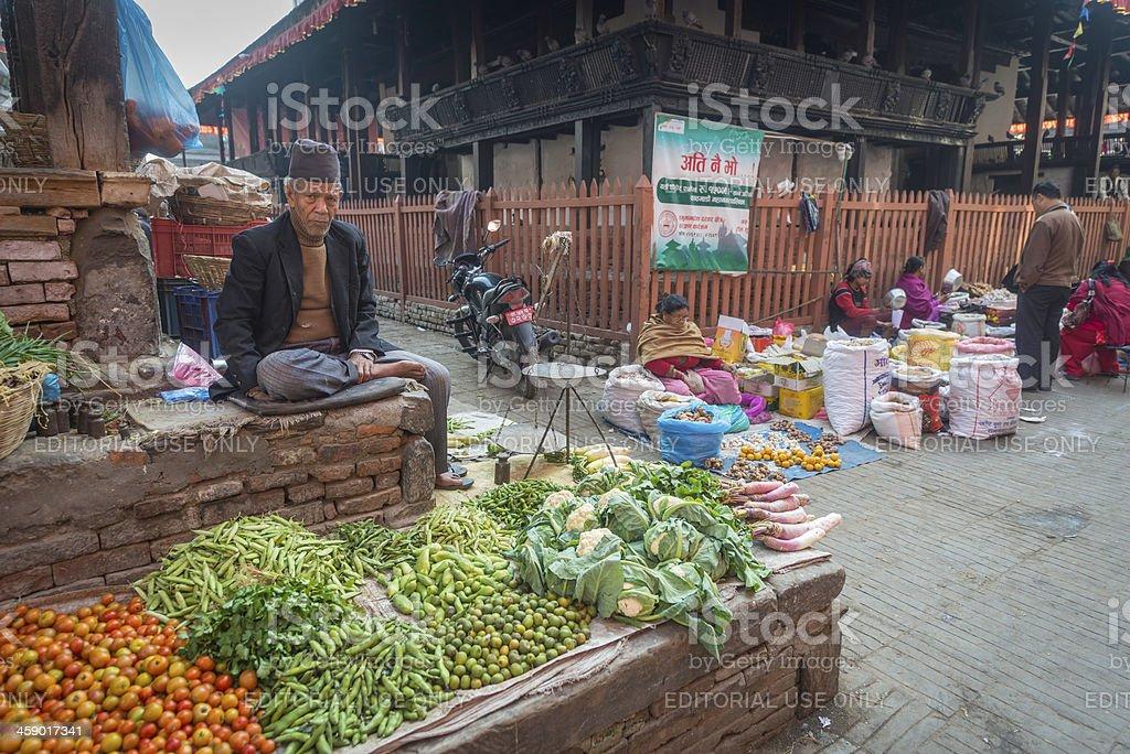 Kathmandu man selling fresh produce in Durbar Square Nepal stock photo