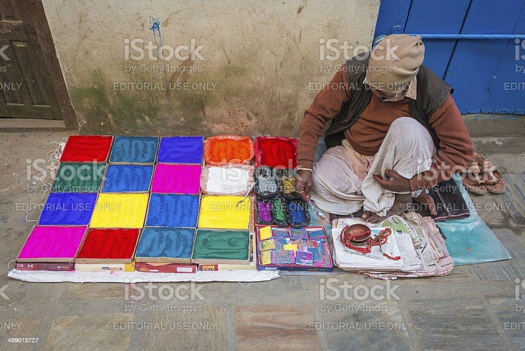 Kathmandu man selling vibrant paint pigment powder Nepal stock photo