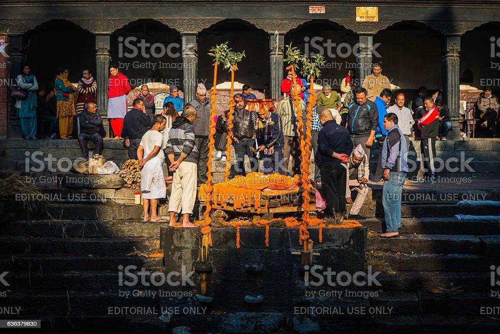 Kathmandu mourners at funeral pyre ghat Pashupatinath temple Nepal stock photo
