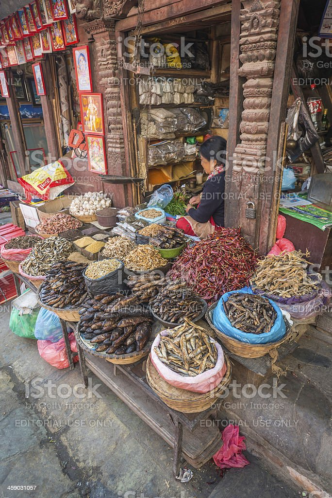 Kathmandu woman selling dried fish and chillies Nepal stock photo