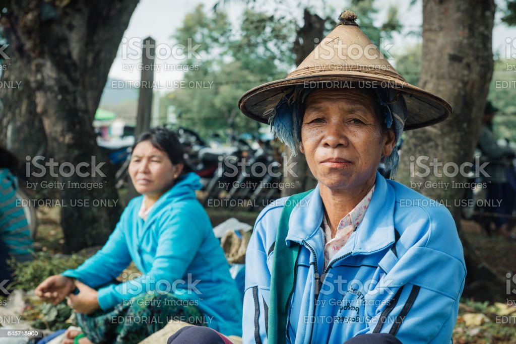 Kayah Burmese woman selling goods stock photo