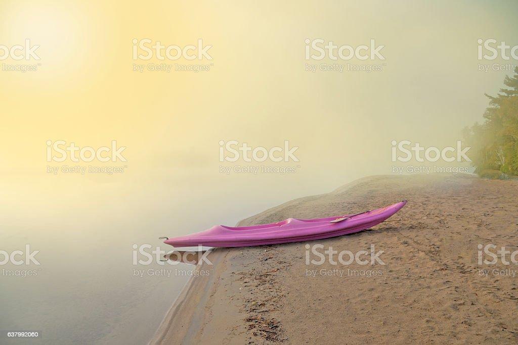 Kayak Boat in the Lake at dawn stock photo