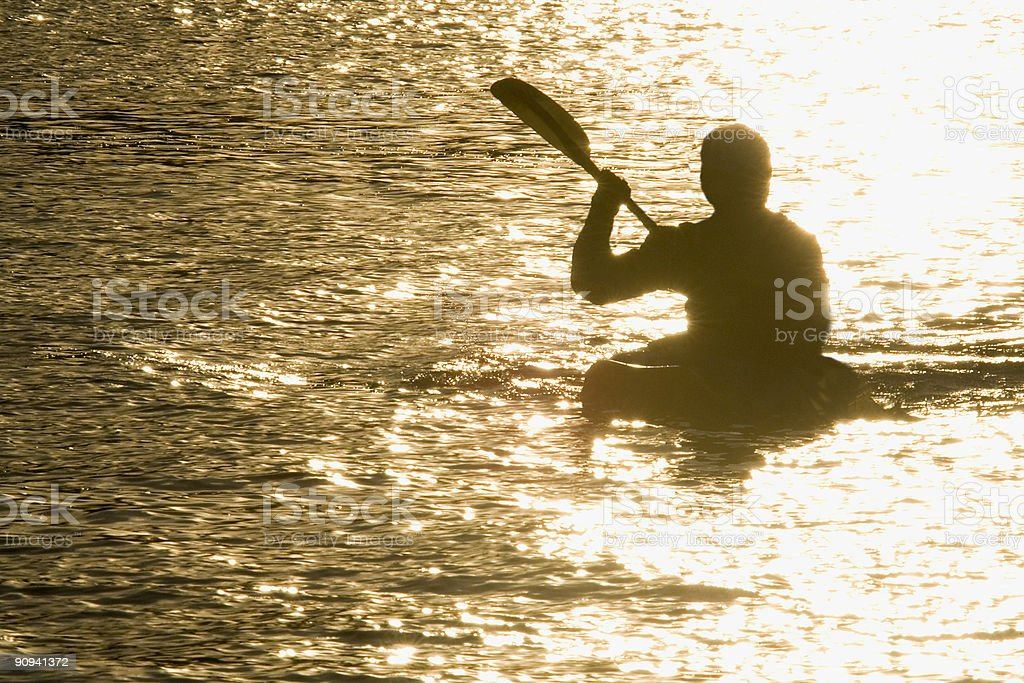 Kayak Canoe On Lake or River At Sunset royalty-free stock photo