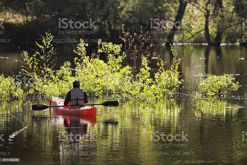 Kayak Fisherman Casting Catching Fish stock photo