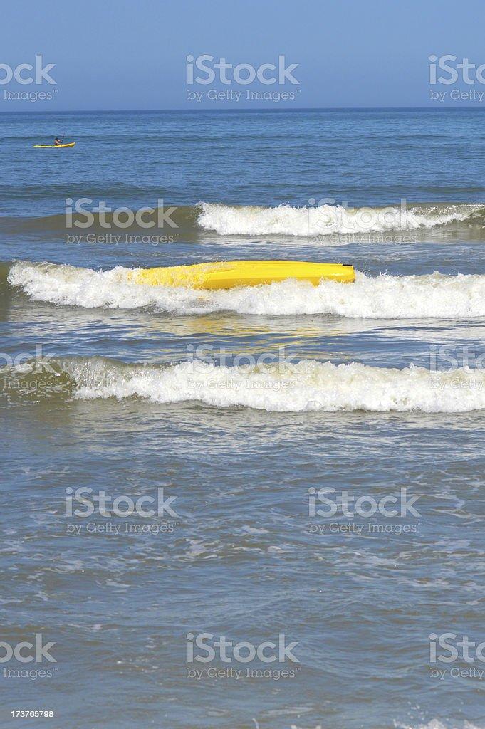 Kayak Flipped In The Ocean royalty-free stock photo