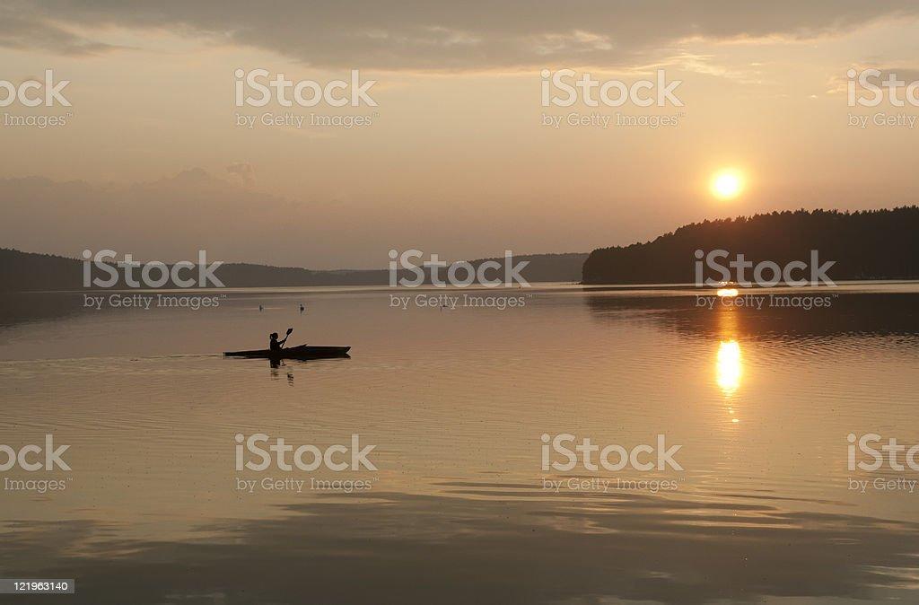 kayak in the sunset stock photo