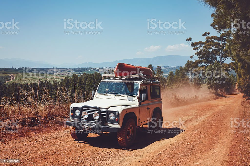 Kayak laden SUV on the country road stock photo