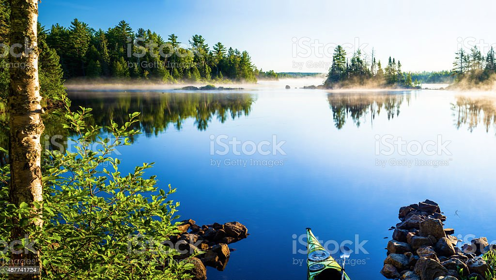 kayak, morning mist, crescent lake stock photo