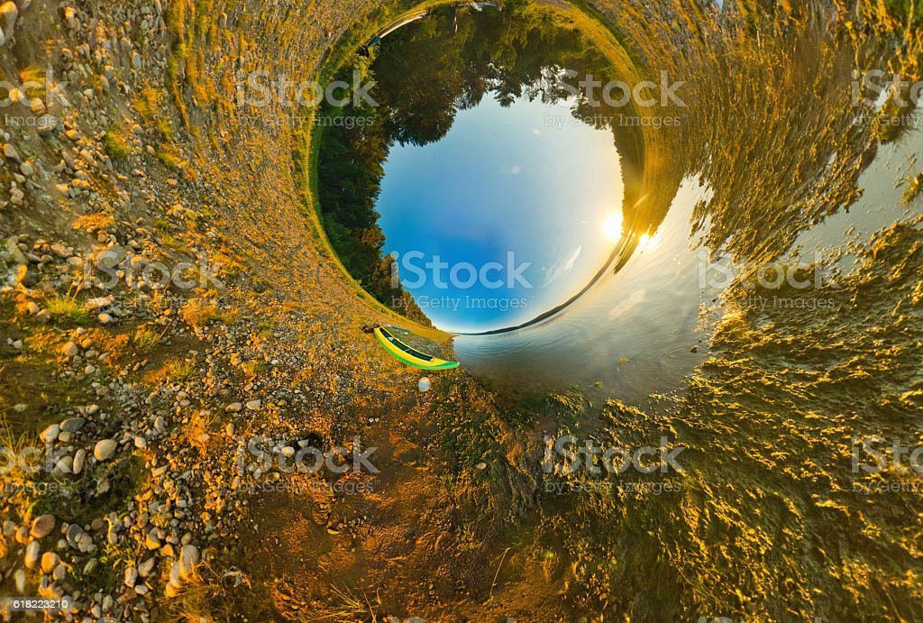 kayak on river coast. Stereographic panorama, little planet stock photo