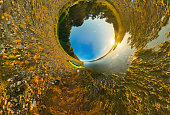 kayak on river coast. Stereographic panorama, little planet