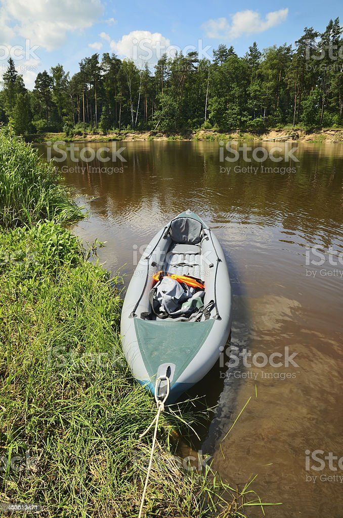 Kayak on the shore of river royalty-free stock photo