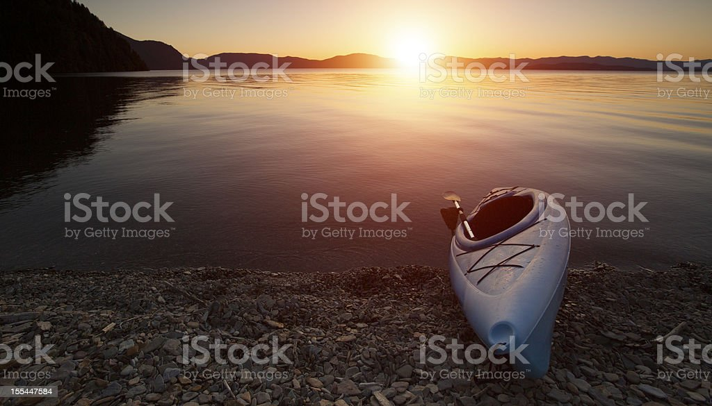 Kayak Sunset on lake Pend Oreille, Idaho stock photo