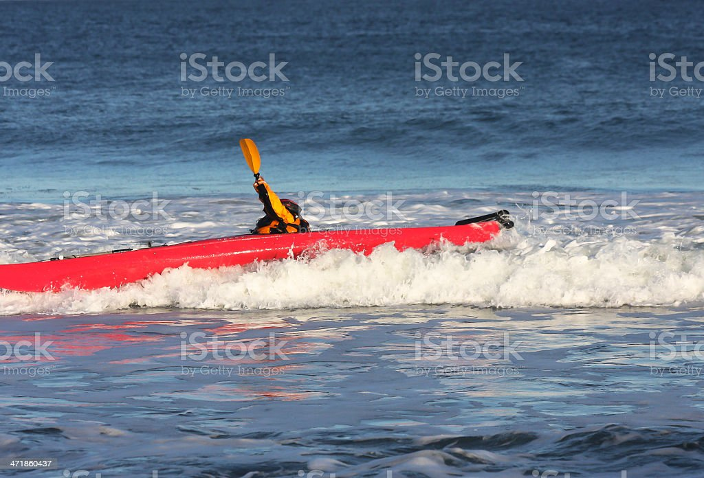 Kayak surfer hitting a rough wave royalty-free stock photo