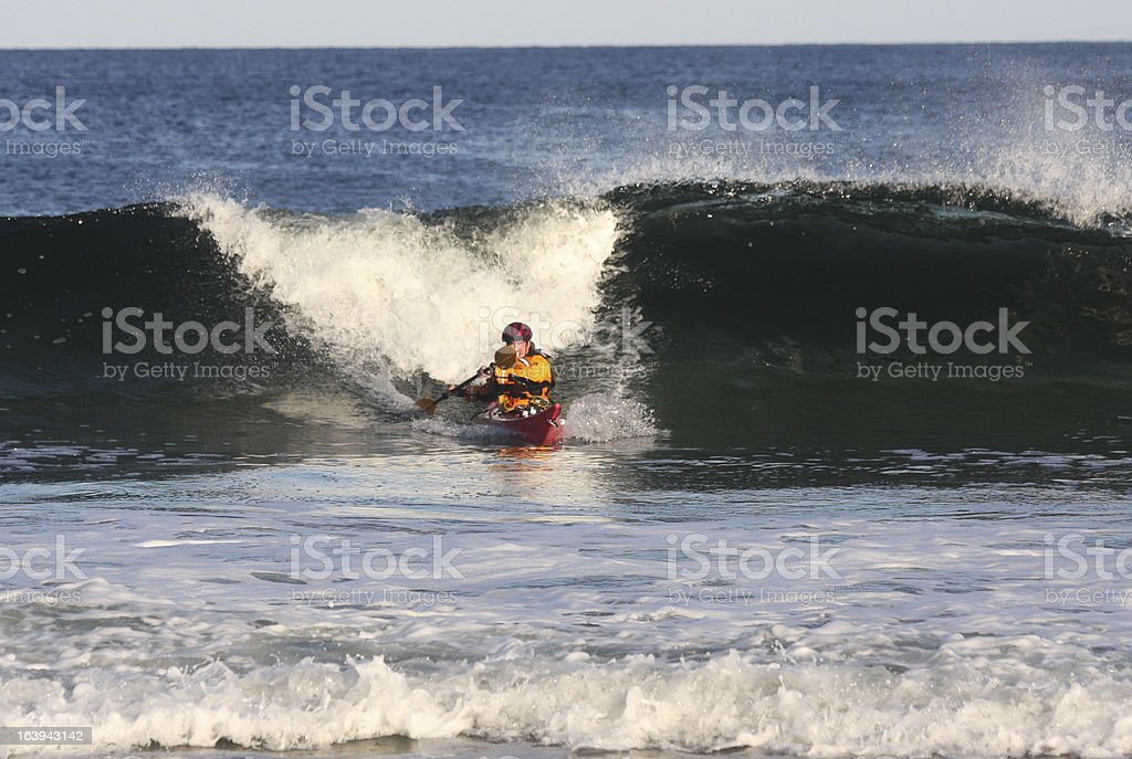 Kayak surfer in action royalty-free stock photo