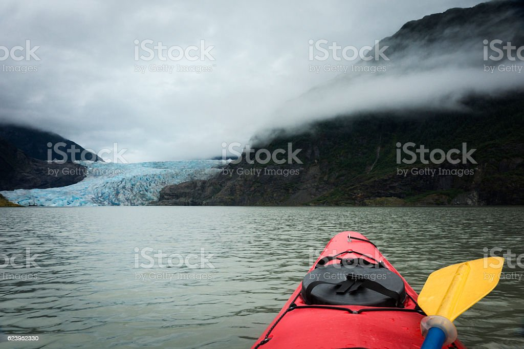Kayaker approaches Mendenhall Glacier stock photo