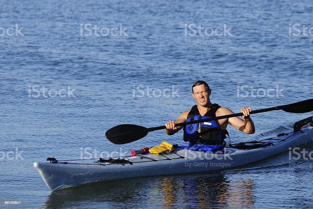 Kayaker arrives squinting in the bright sunlight royalty-free stock photo