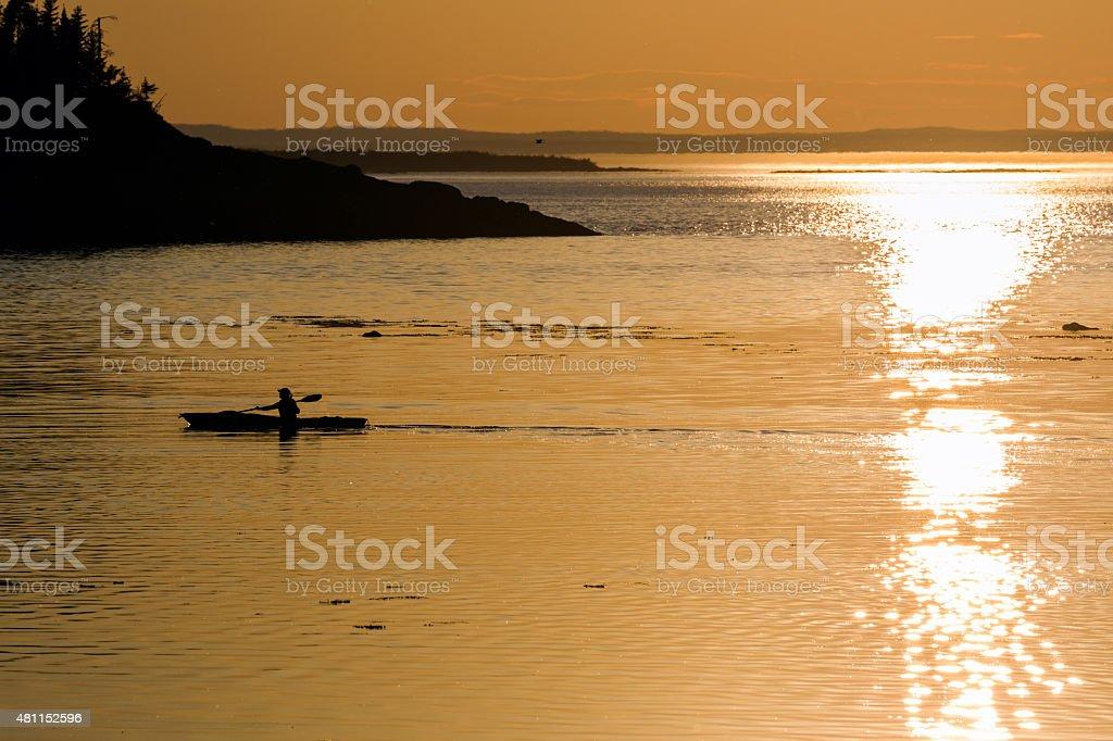 Kayaker at Sunset stock photo