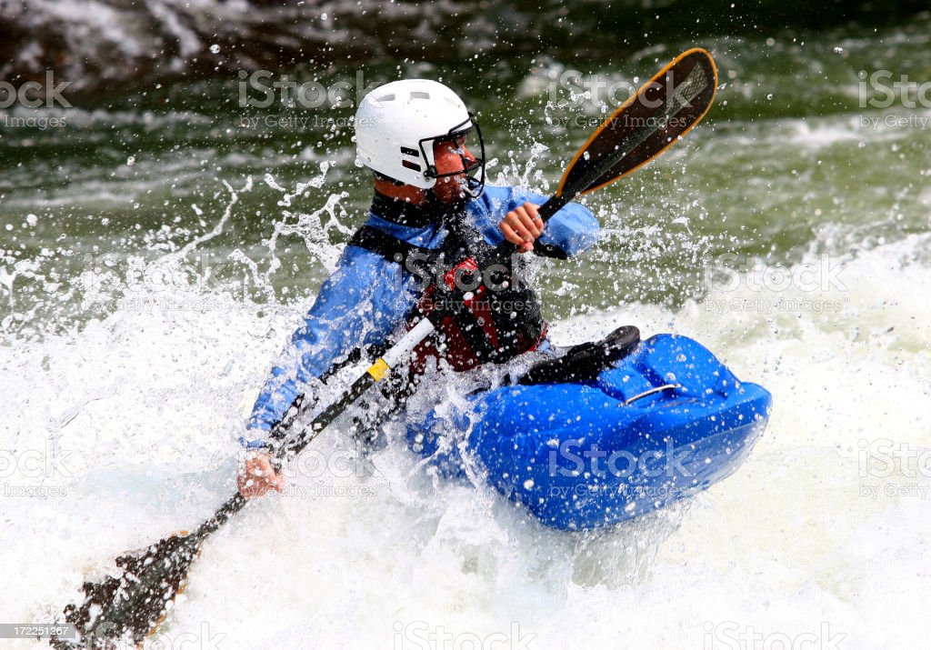 Kayaker busy tackling the rushing river royalty-free stock photo