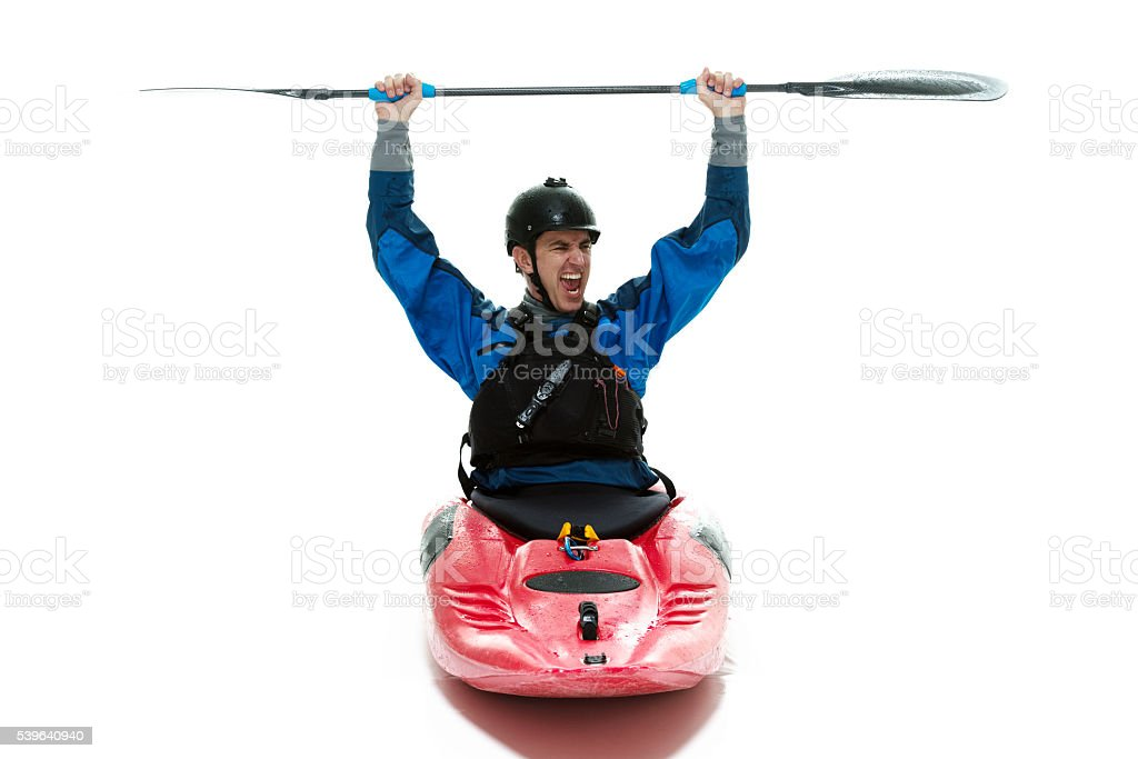 Kayaker cheering with  oar stock photo